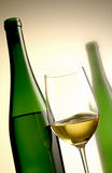 Bottles and glass of white wine Stock Photos