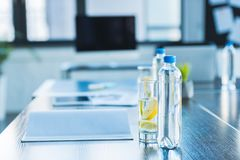 Bottles and glasses with antioxidant drink for business meeting in office royalty free stock photography