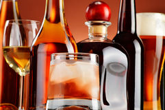 Bottles and glasses of assorted alcoholic beverages Stock Photos