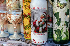 Bottles and glasses decorated for Christmas Stock Image