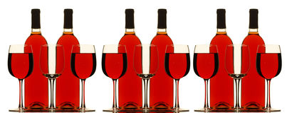 Bottles and Glasses  filled with red wine Royalty Free Stock Image