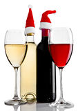 Bottles and glasses of red white wine santa hat. On white background stock images
