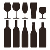 Bottles and glasses set Stock Images