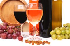 Bottles and glasses of wine and ripe grapes. Barrel, bottles and glasses of wine and ripe grapes on wooden Stock Images