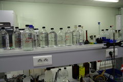 Bottles and glassware in a laboratory Royalty Free Stock Image
