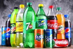 Bottles of global soft drink brands. POZNAN, POLAND - APR 6, 2018: Bottles of global soft drink brands including products of Coca Cola Company and Pepsico royalty free stock images