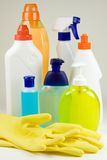 Bottles and gloves. Colored plastic detergent bottles and yellow rubber gloves Stock Photography