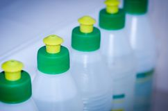 Bottles for glue/row from bottles for glue. Bottles for glue/ row from bottles for glue, blue toning royalty free stock image