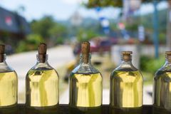 Bottles of golden transparent liquid Royalty Free Stock Images