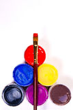 Bottles with gouache paints and brush for artistic paintings. Stock Photo