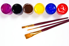 Bottles with gouache paints and brushes for artistic paintings. Royalty Free Stock Image