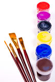 Bottles with gouache paints and brushes for artistic paintings. Stock Photo