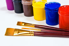 Bottles with gouache paints and brushes for artistic paintings. Stock Image