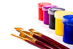 Bottles with gouache paints and brushes for artistic paintings. Stock Photography