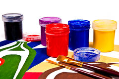 Bottles with gouache paints and brushes for artistic paintings. Royalty Free Stock Photography