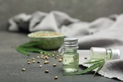 Bottles of hemp extract on table. Bottles of hemp extract on grey table stock photography