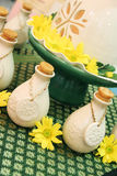 Bottles of herbal spa oils and flowers. Royalty Free Stock Photo