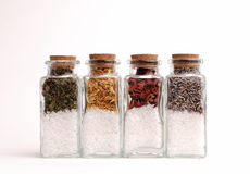 Bottles of Herbs and Sea Salts Stock Photo