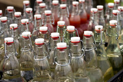 Bottles with homemade alcohol Royalty Free Stock Photography