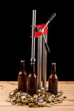 Bottles  of homemade beer  and bottle capping machine Royalty Free Stock Images
