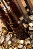 Bottles  of homemade beer  and bottle capping machine Royalty Free Stock Photography