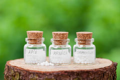Bottles with homeopathy globules Stock Photo