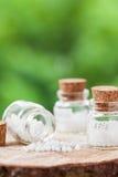 Bottles of homeopathy globules Stock Photos
