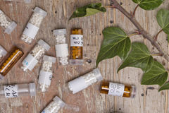 Bottles with homeopathy globules Stock Images