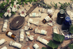 Bottles with homeopathy globules and spoon Stock Images