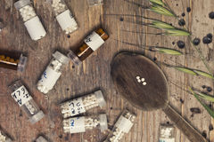 Bottles with homeopathy globules and spoon Stock Photos
