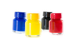 Bottles of ink in cmyk colors Stock Image