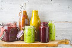 Bottles and jar with different smoothie on the  wooden board horizontal Stock Photo