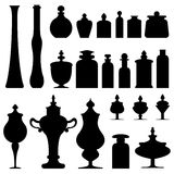 Bottles, jars, and urns from apothecary or herbali. Vector silhouette set of bottles, urns, jars, and glassware from apothecary, herbalist, druggist or chemist Royalty Free Stock Image