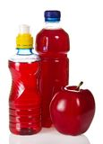 Bottles with juce and red apple Stock Image