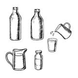 Bottles, jugs and glass of milk Royalty Free Stock Photo