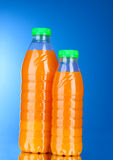 Bottles with juice Stock Photos