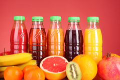 Bottles of juice  with ripe fruits Stock Photography