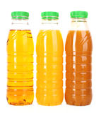 Bottles of juice on a white Stock Photography
