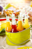 Bottles of lemonade standing in green bucket Stock Images