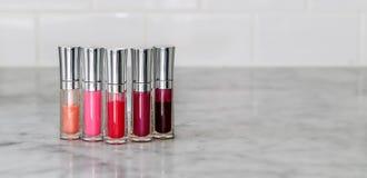 Bottles of lip gloss. Variety of lip gloss, variety of lip gloss Stock Photo