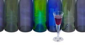 Bottles and a liqueour glass. Decorative still life with a set of bottles and a liqueour glass Stock Image