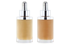 Bottles of liquid foundation with dropper in pink and yellow und Stock Images
