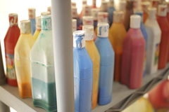 Bottles of Liquid Paint on Shelf Stock Photo