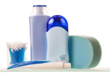 Bottles with liquids, toothpaste and brush, cotton swabs, sponge isolated. Stock Photo