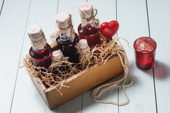 Bottles of liquor in a wooden box stock photo