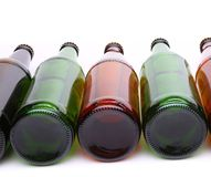 Bottles lying in row. The bottoms of bottles close-up Royalty Free Stock Photo