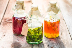 Bottles made of honey, linden, mint and alcohol Stock Image