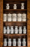 Bottles with medicines on the shelf in old pharmacy. Old pharmacy, medicine and chemistry background. royalty free stock photography