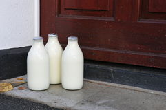 Bottles of Milk on a Doorstep. Of a London House Royalty Free Stock Image