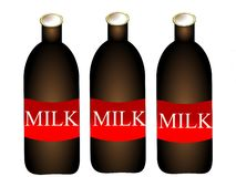 Bottles with milk Stock Images